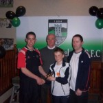 David Bellew with 2005 U-12 Player of Year. Also in photo Gerry Nixon, Chairman (centre) and U-12 manager Pat McCarthy (right)