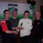 Louth player John O'Brien presents the 2005 U-14 Player of the Year Award to Nicholas O'Connor watched by Chairman Gerry Nixon and U-14 manager Enda Murray