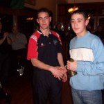 Louth player John O'Brien presents the 2005 U-14 Merit Award to Robert McKinley watched by John Laverty, Enda Murray and Chairman Gerry Nixon.