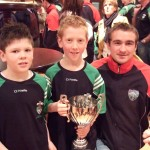 Seatown/Cluan U-10 players Jordan O'Donoghue and Dean Maguire with the 2006 Cumann Peil na nOg cup and Louth star Paddy Keenan