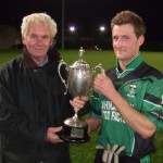 County Board Vice Chairman Jim Thornton presents the Macardle Cup to Dundalk Young Irelands winning captain Aaron Rogers