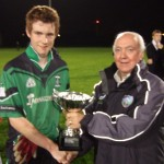 Minor Board Chairman Tomas O hEochaidh presents the U-15 Cup to Dundalk Young Irelands winning captain Nicholas O'Connor