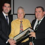Brian Sheehan and Chairman Barry McDermott presenting Sean Og Flood with his Hall of Fame Award